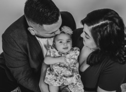 Photography of family snuggling new baby