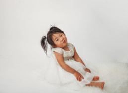 Toddler poses for holiday photo in studio