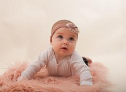 Toddler in studio photo shoot in Pasadena, California with pink decorative rug