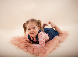 Toddler sits for in studio photo shoot in Pasadena, California with valentine day session