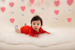 Baby in studio photo shoot in Pasadena, California with valentine day backdrop